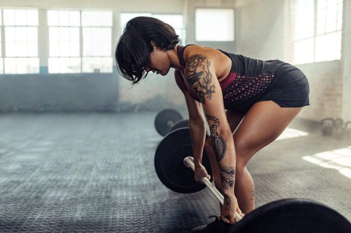 woman about to do a deadlift