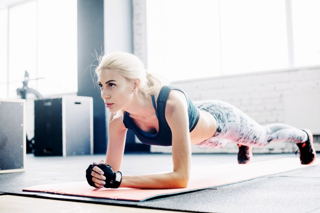 woman doing a plank as part of an at home abs workout