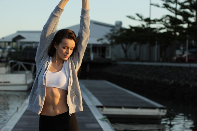 woman with abs stretching
