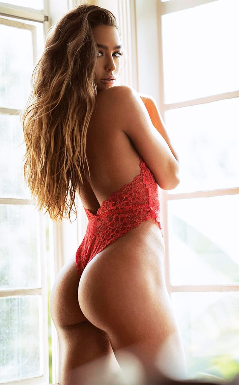 Sommer Ray posing in red lingerie , showing off her incredible booty and figure.