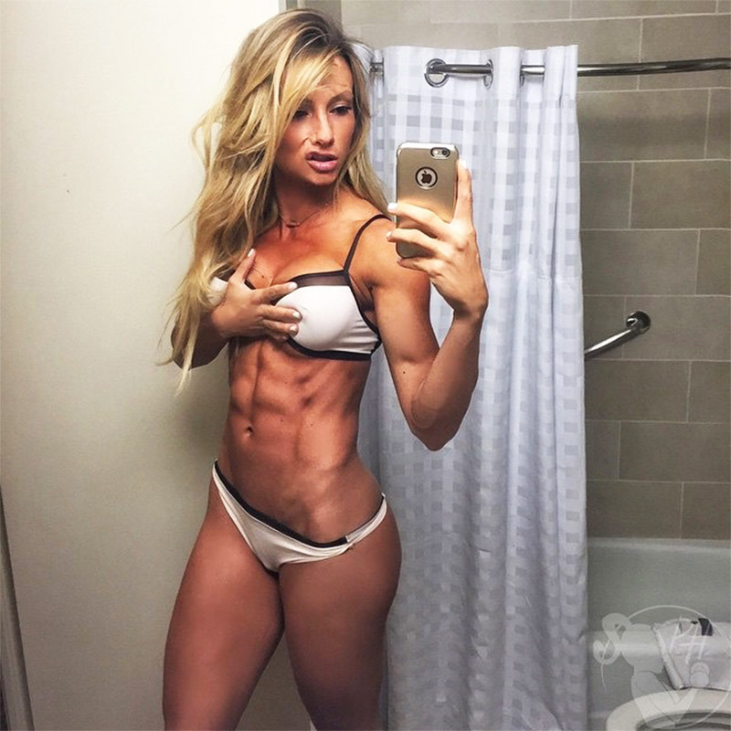 Paige Hathaway posing in the bathroom in a bikini showing off her incredible abs and figure.