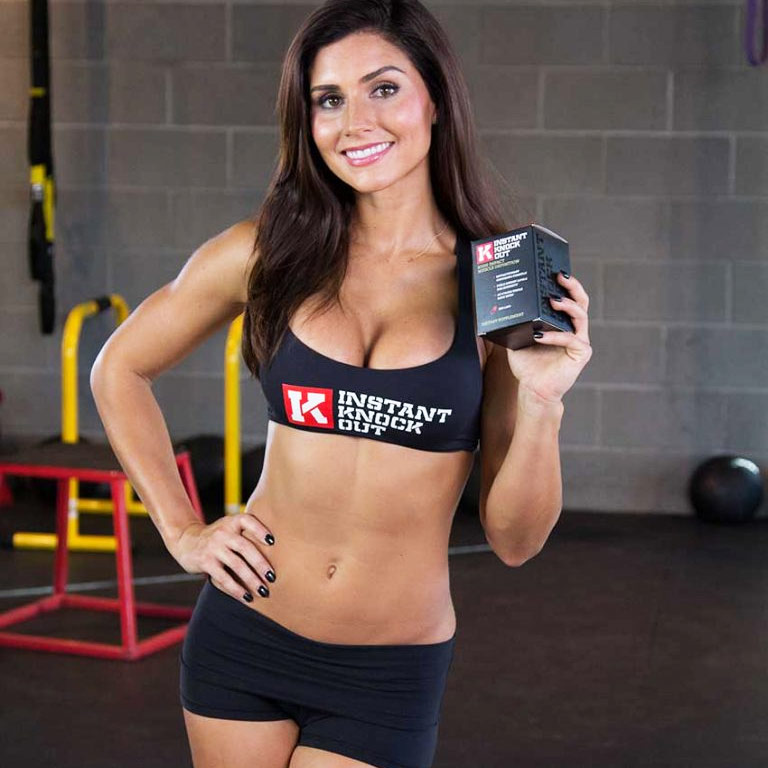 Alexia posing on set during a professional photoshoot as she promotes a fat burner called Instant Knockout as a fitness model.