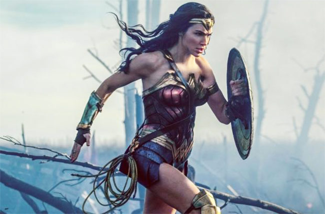 Gal Gadot running in her wonder women costume on the set of the movie.