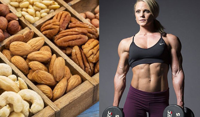 bodybuilding woman standing next to a picture of nuts