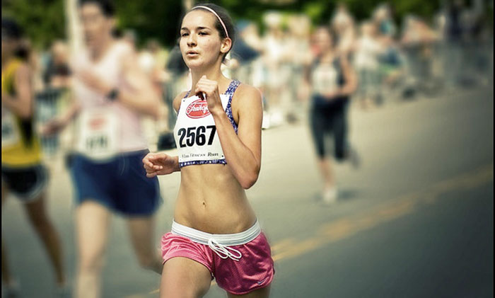 long distance female runner taking part in a race