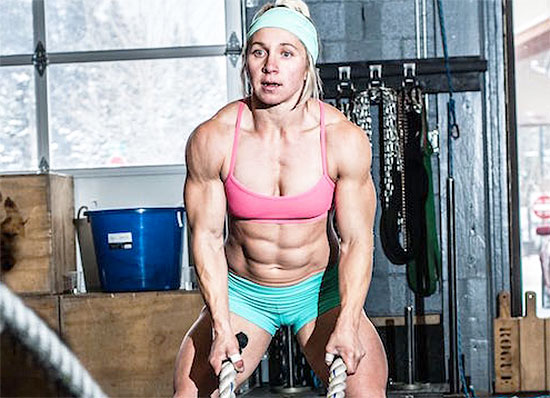 woman bodybuilder using steroids performing rope exercises