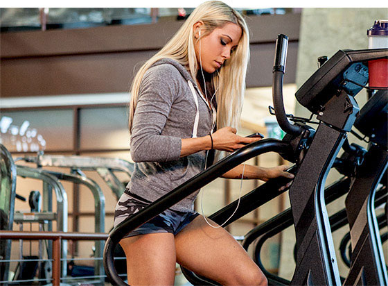 woman doing exercise on the stairmaster