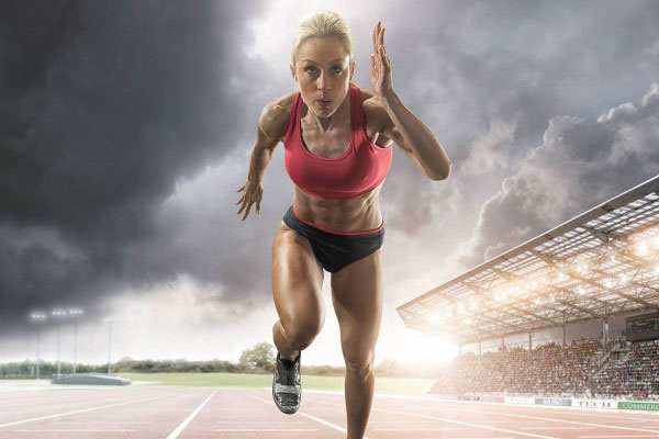 woman sprinting working out hard looking happy building lean muscle