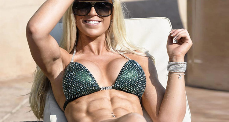 a fitness model in her bikini showing her incredible abs