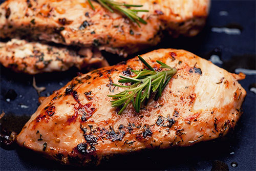 a chicken breast cooked in a marinade and herbs