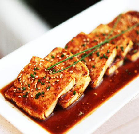 tofu served in an asian dish with soy sauce as a high protein source