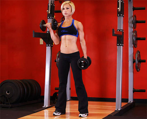 A picture of jamie eason performing alternate dumbbell curls