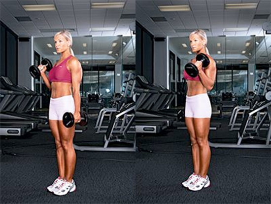 a girl performing alternate hammer curls in the gym