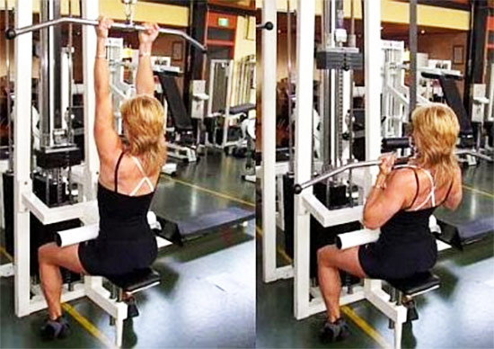 a female performing bicep pulldowns as part of her bicep workout in the gym