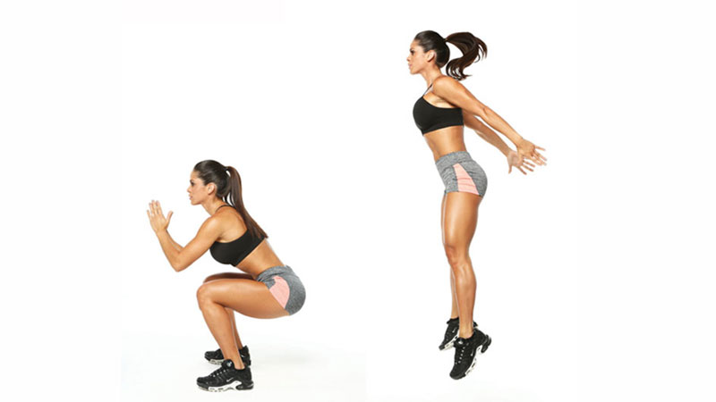 Female athlete performing jump squats to build her booty