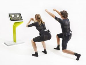 Man and women performing electrical muscle stimulation - Avoid EMS Training trend