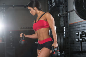 Leah Ward performs kettlebell curls