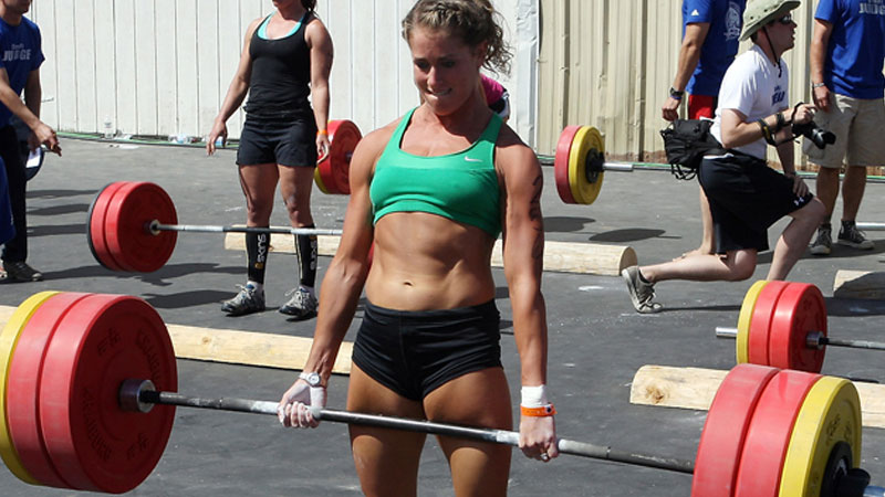 Female athlete deadlifting at a competition