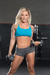 Niki Zager poses with dumbbell