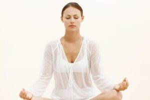 Young woman practicing power breathing