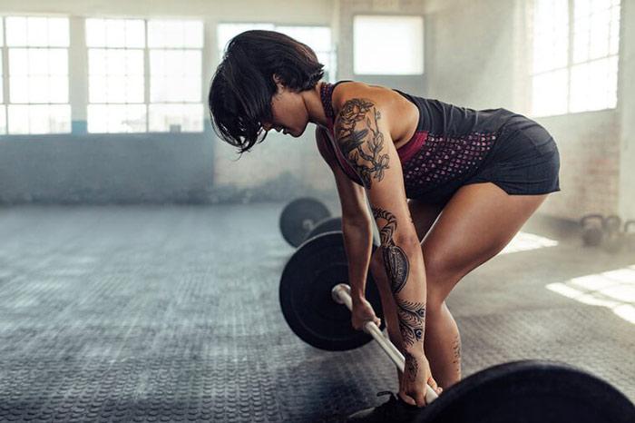 woman performs basic hip hinge