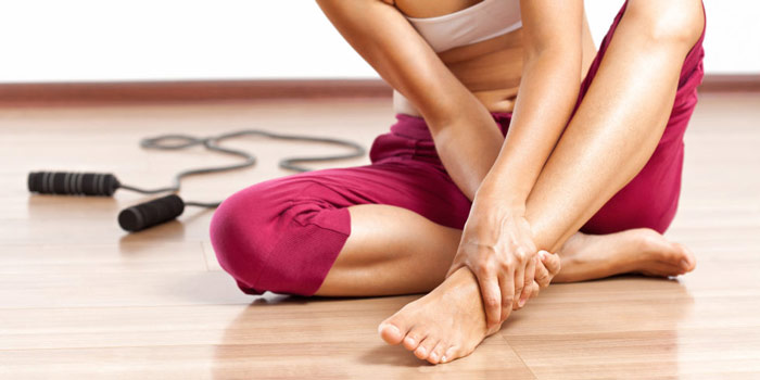 woman in gym with injured ankle