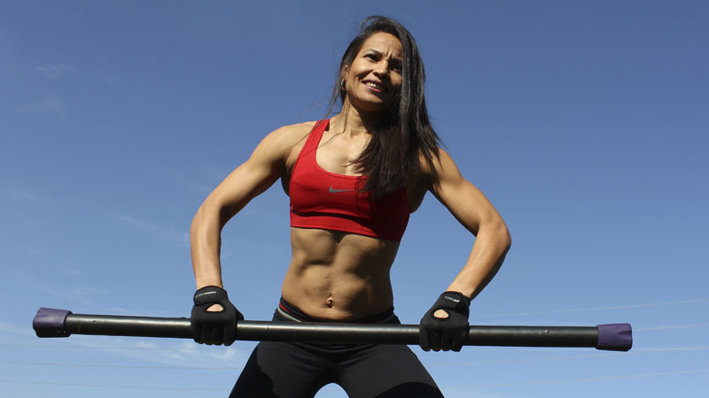 Older woman after 50 lifting weights for muscle building