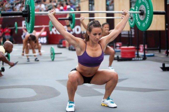 Female athlete performing overhead squats in weightlifting shoes