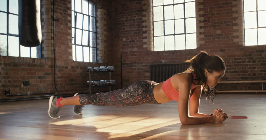 Woman with long hair doing plank