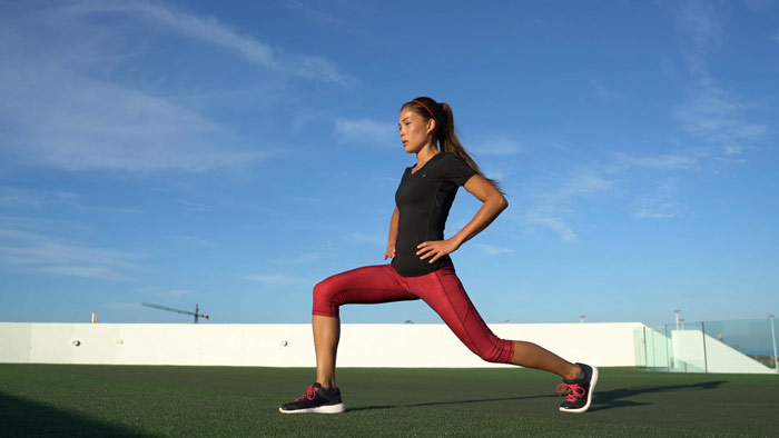 Woman performs forward lunge