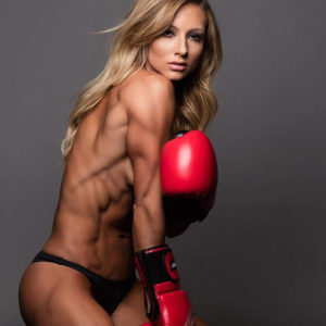 Paige Hathaway posing in boxing gloves