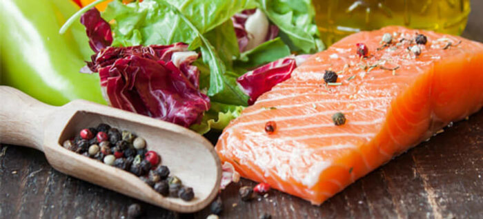 Example of a pescatarian diet featuring salmon and black peppercorns