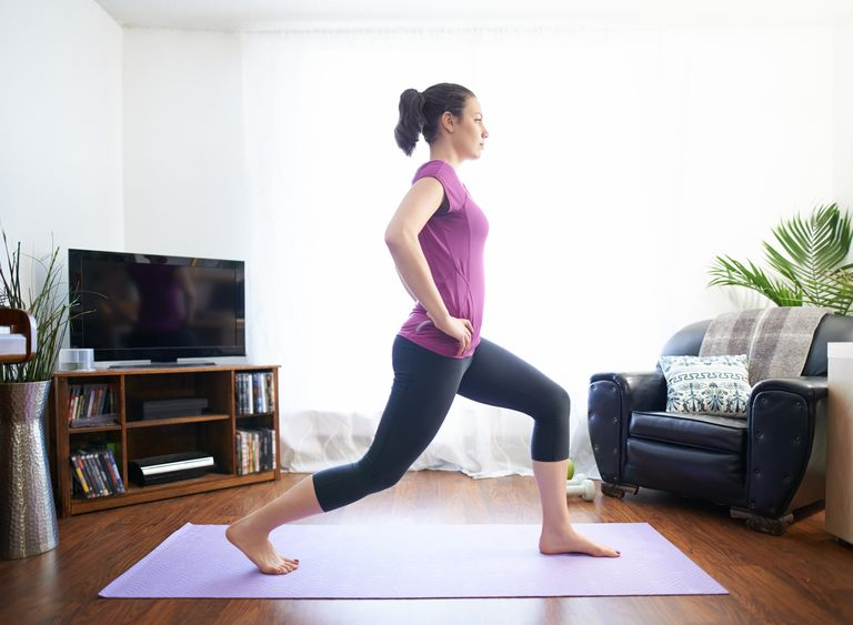 Woman taking part in beginner strength training workout at home