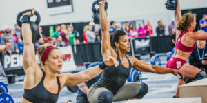 women perform crossfit kettlebell snatch