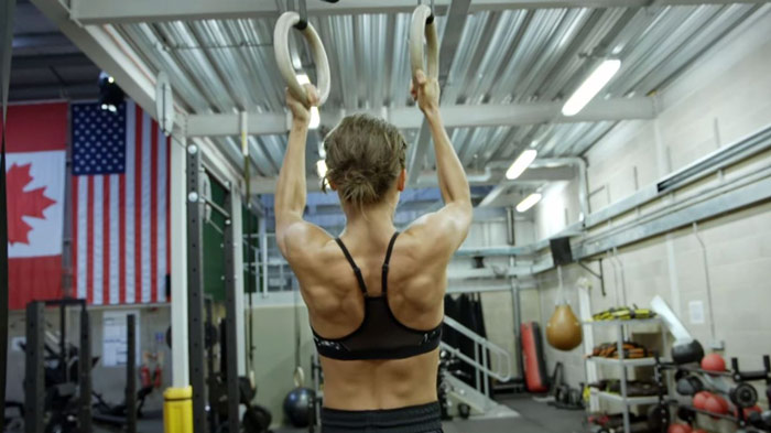 Alicia Vikander performing ring pull ups for Tomb Raider workout