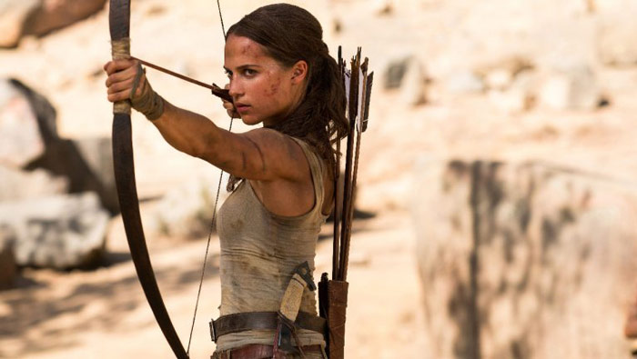 Alicia Vikander shooting bow and arrow as Lara Croft from Tomb Raider