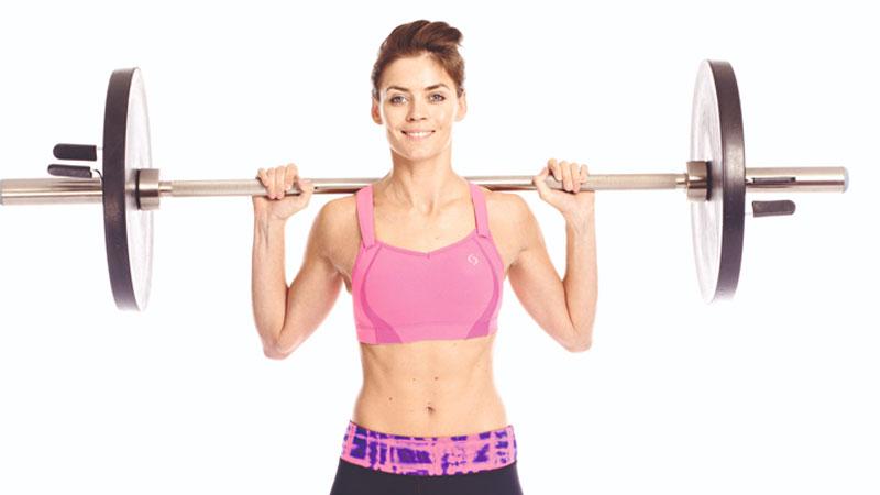 Health woman lifting weights
