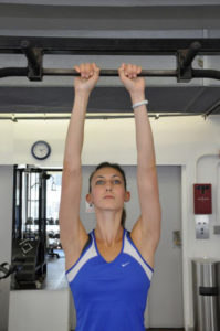 close grip pull up demonstrated by female