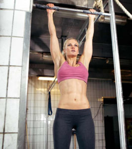 female athlete performing strict pull up with great form
