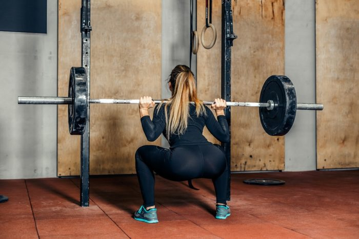 woman performing back squat