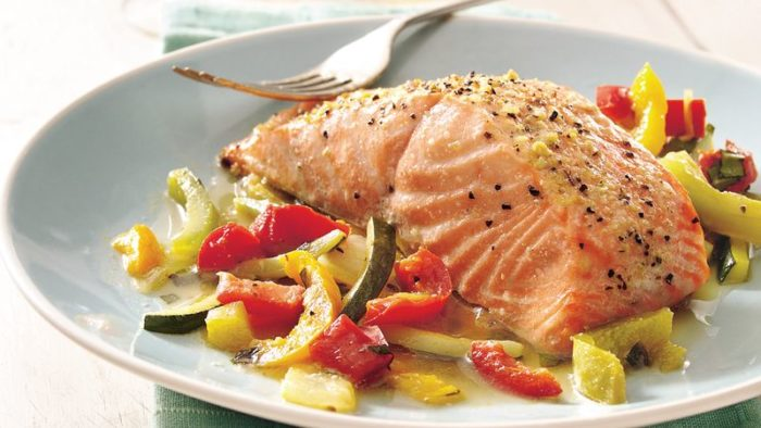 high protein salmon on a bed of vegetables
