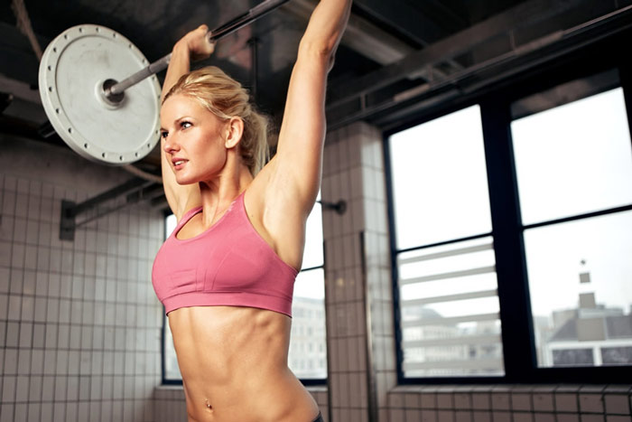 weightlifting woman building muscle to replace body fat