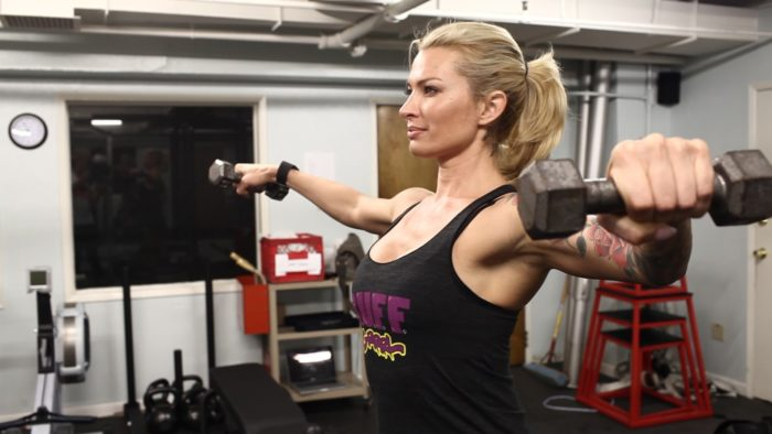 Woman with defined shoulders doing a lateral raise