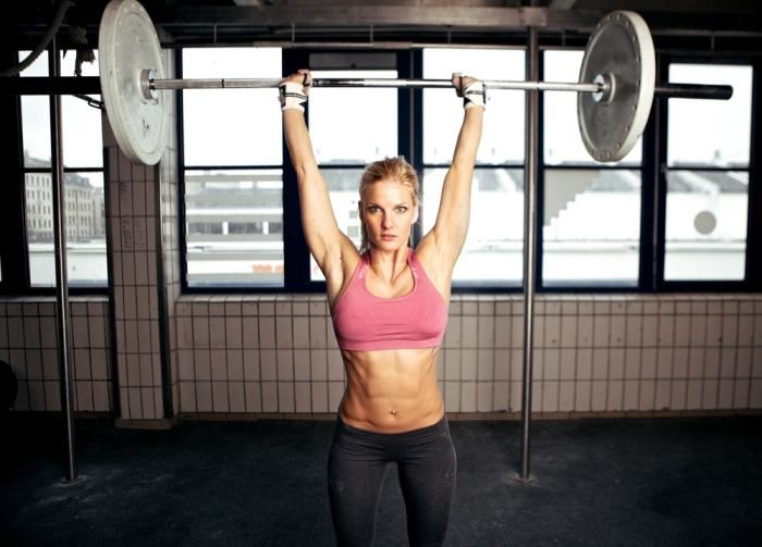 Woman performing an overhead press