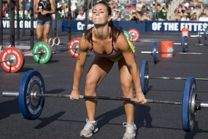 Woman at the bottom of a pendlay row
