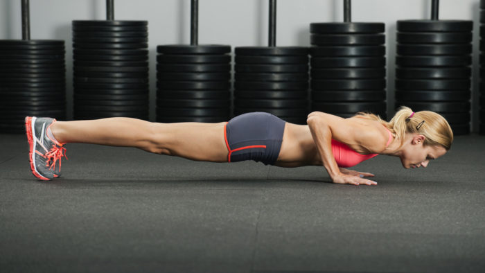 Woman performing a press-up