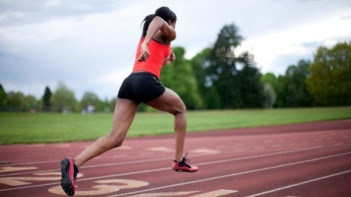 Woman sprinting on a running course