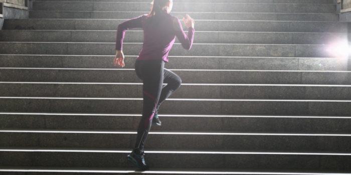 Women running up stairs