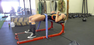 banded hip thrust demonstrated by female athlete