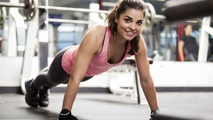 Becoming a personal trainer - woman working out in the gym